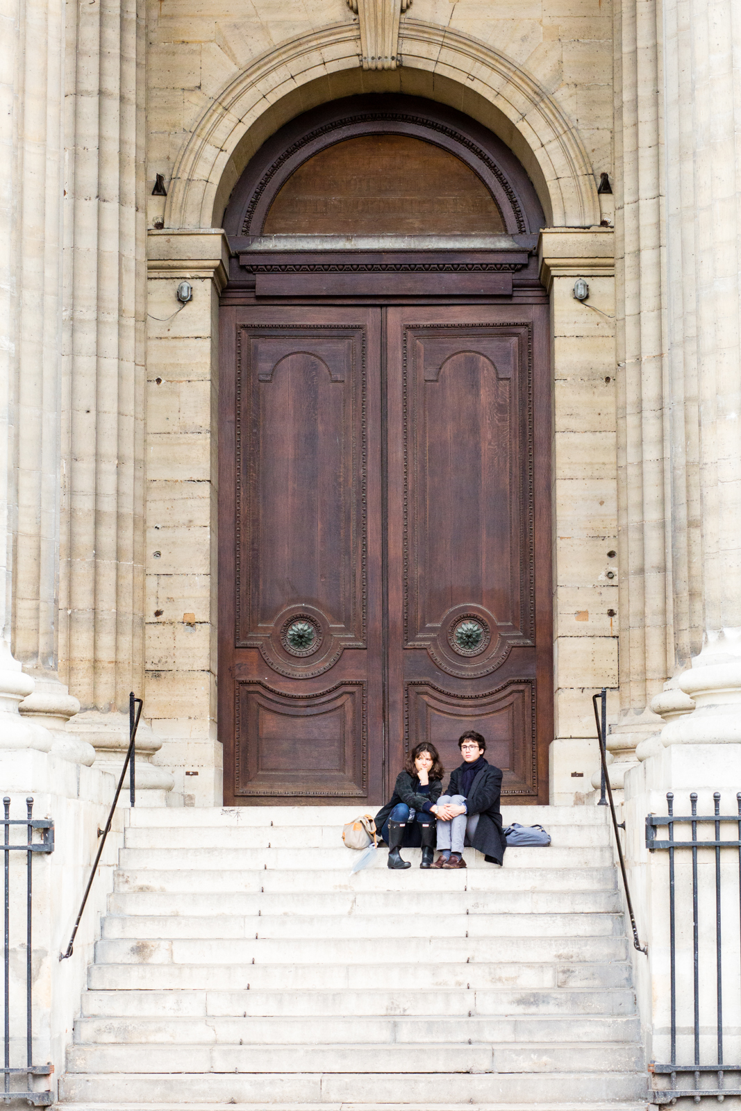 Couple sitting on the steps of the Church of Saint-Sulpice, Paris